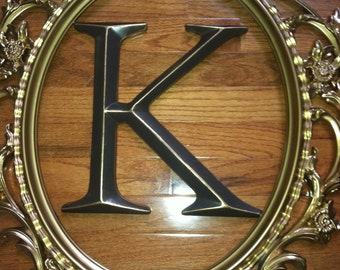 large oval ornate frame with capital letter large open back frame you choose letter