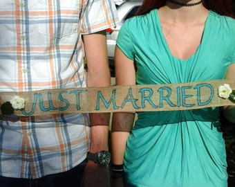 Just Married rustic/country sign on burlap - with silk white flowers / teal letters...sticks on each end to hold.  Ready to ship!
