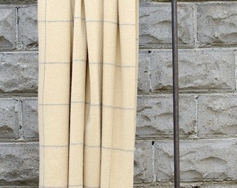 Yellow with thin grey checks, alpaca and lambswool throw/shawl hand-finished with fringed edges.