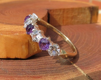 A vintage 9K yellow gold amethyst and white topaz ring