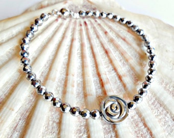 Hematite silver bracelet with flower and magnetic clasp