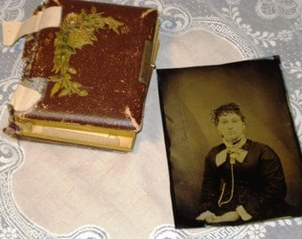 Rare tin types in photo album including 10 small tin types and other photos.  One large tin type included.