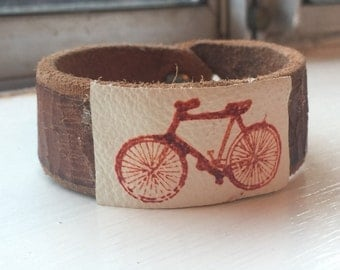 Leather wrist cuff with bicycle print
