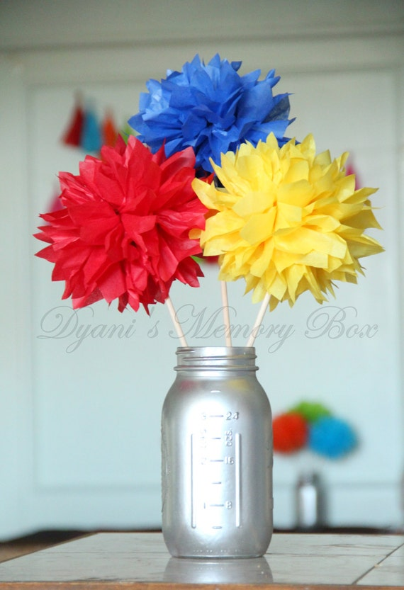Set of primary colors handmade tissue pom flowers