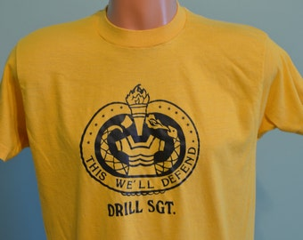 "80s T-Shirt ""This We'll Defend""  US Army Drill Sergeant Official Army Motto Screen Stars XL Yellow Tee"