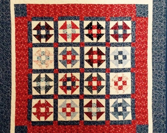 Patriotic red white and blue Churn Dash hand made patchwork quilt