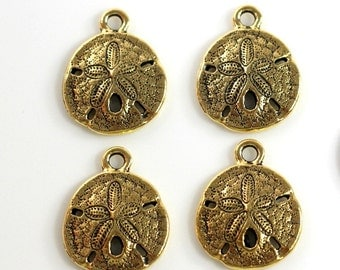 "4 Pieces~""Sand Dollar Shell"" ByTIERRACAST~ Antiqued Gold Plated Lead Free Pewter~4 Pieces"