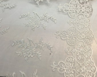 Ivory jasmine flower design embroider and corded on a mesh lace-yard