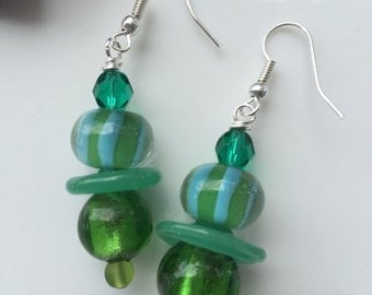 Lampwork glass Green beaded dangly earrings on sterling silver earwires.