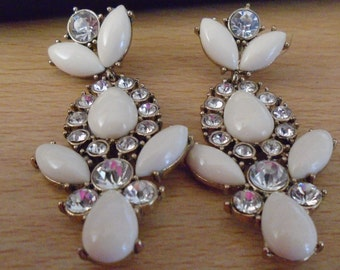"""vintage goldtone metal dangling  earrings clear stones/cream lucite 2.5""""drop 1.25""""in top condition"""