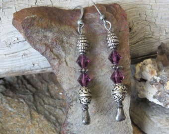 Metallic and purple dangle earrings.