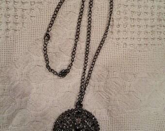Black round pendant