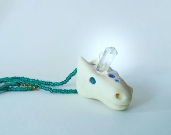 Unicorn with quartz crystal horn, glows in the dark
