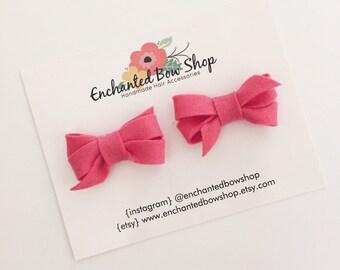 Pink felt pigtail bows
