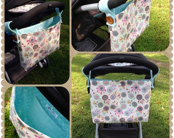 STROLLER CADDY! Stroller Bag. Fits most strollers. Straps snap onto the stroller handles. Fully lined. Interior pocket. Snap Closure.