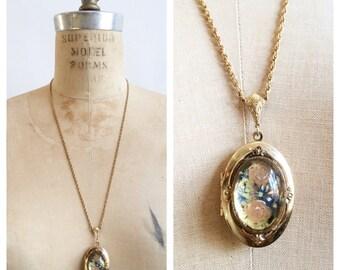 Floral dome locket necklace.
