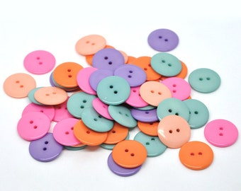 25 Mixed Resin Buttons 23mm. Orange Mix. Ideal for sewing, scrap booking, card making, jewellery, and other craft projects