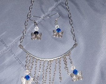 Blue butterfly necklace with earrings