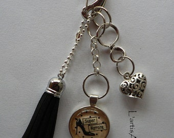 Bijou de sac Pompon Noir Cabochon Verre Super Marraine Cadeau Marraine.