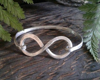 Infinity Bracelet made from recycled aluminum.