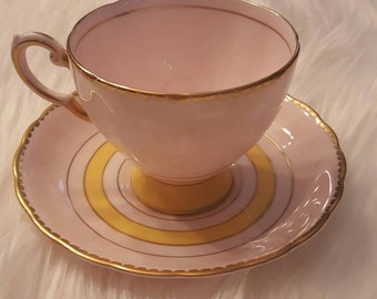 Vintage Pink Gold rimmed Tuscan Teacup and saucer.