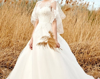 Lace tulle gown with butterfly lace sleeves
