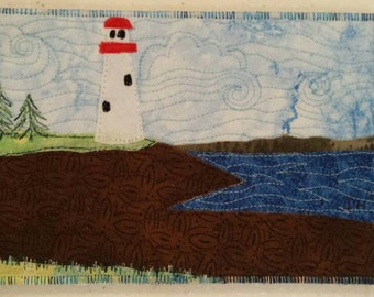 Lighthouse on the Bay of Fundy New Brunswick Quilted Postcard Fabric Postcard Darcy Doodle Quilts Fiber art thread painting