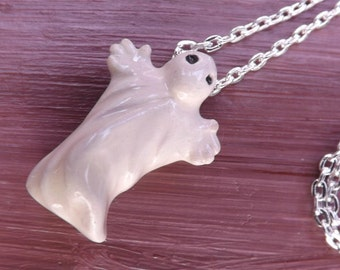 Ghost pendant on a silver-plated chain. Ceramic phantom necklace