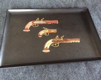 Vintage Couroc tray with flintlock pistols