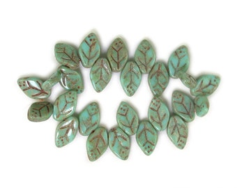 Turquoise Green opaque w/ picasso rustic 7 x 12mm leaves. Set of 25, 50 or 100.
