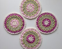 Crochet coasters in spring colours. Handmade mandala coasters. Spring table decor. Crochet table mats.