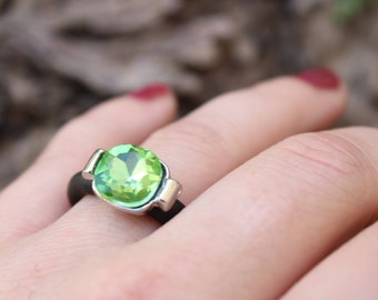 Green glass ring with black rubber. adjustable ring