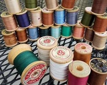 Large collection of vintage thread on wood spools