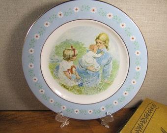 Avon Commemorative Plate - Tenderness - Pontesa Ironstone - Mother and Children - Pale Blue Rim - White Flowers