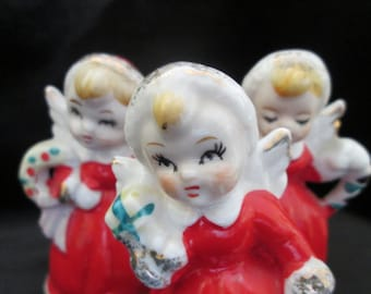 Vintage Japan Christmas Holiday Decor Three Angels Red Dresses Gold Trim Blond Hair Candy Canes Wreaths and Presents