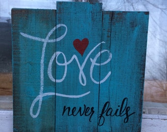 valentine sign, heart sign, love sign,Love never fails, aqua wood sogn. White, black and red accents, wall hanging.