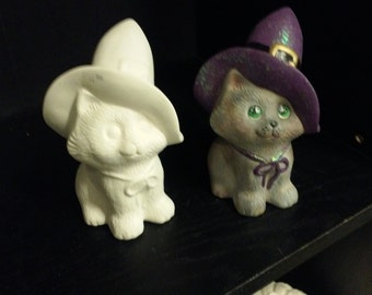 Finished Ceramic Cat with Hat as shown in picture.