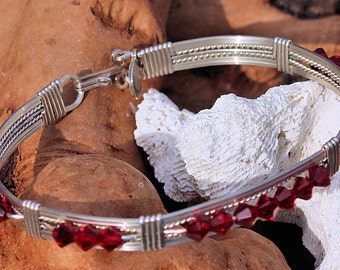 Sterling silver bracelet with dark red crystals