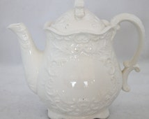 Napcoware White Porcelain Teapot Embossed in a Lovely Scroll Pattern