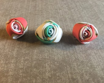 Little rolled up rose lapel pin