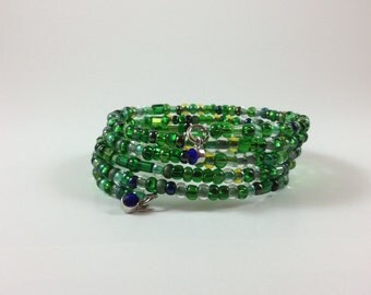 Emerald green mix  glass beads  memory wire bracelet with rhinestone charms