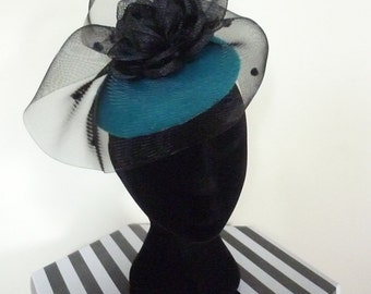 Ladies perched button hat teal with black swirl for wedding or races