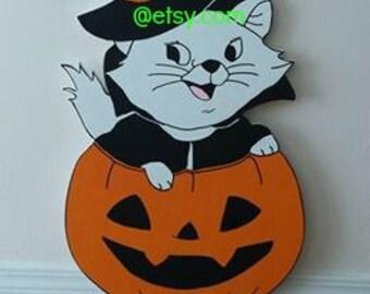 Halloween Cat in a Pumpkin