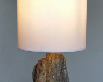 Unique table lamp with natural stone foot