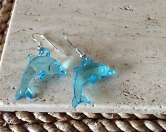 Make A Splash With These Adorable Acrylic Clear Aqua Blue Playful Dolphin Hook Earrings.