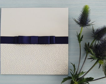 Ice White Pocketfold Invitation With Pebble Finish and Navy Blue Double Satin Bow