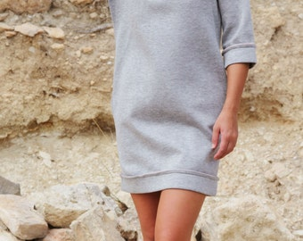 Grey sweater dress with pink details and pockets.one-size.