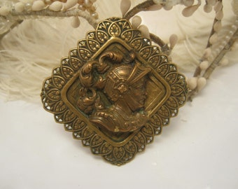 Antique French Brass brooch man with a mustache in armor knight