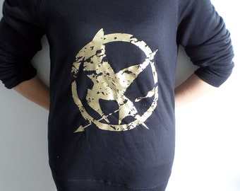 The Hunger Games Mocking Jay distressed gold print slouch sweatshirt for women