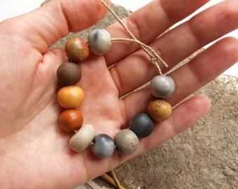 Set of 11 unique ceramic beads, handmade